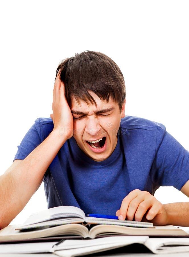 Estudiante cansado que bosteza imagen de archivo libre de regalías