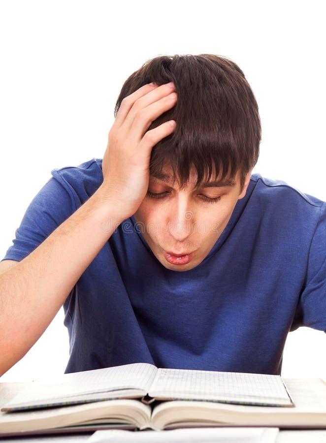Estudiante cansado y preocupado imagen de archivo