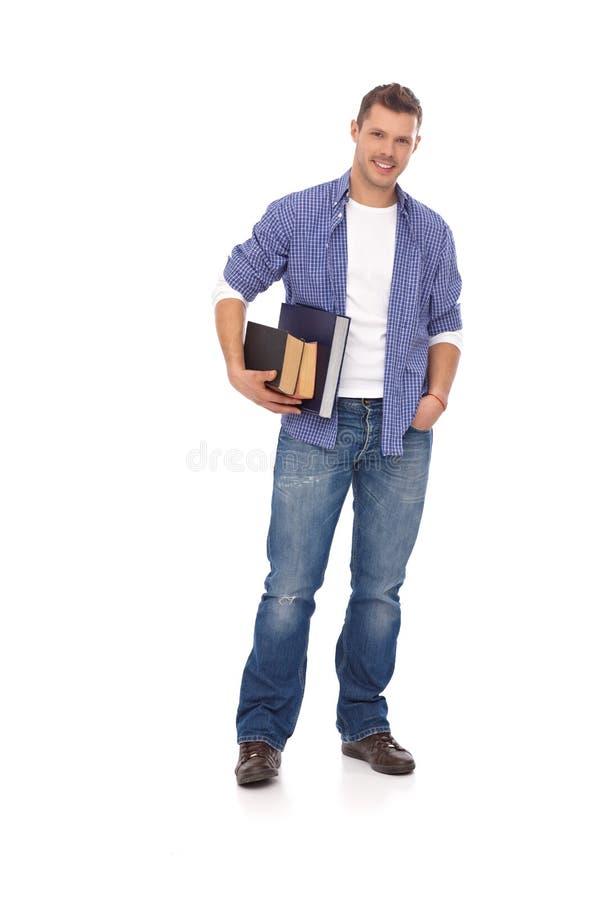 Estudiante casual que sostiene los libros imagen de archivo
