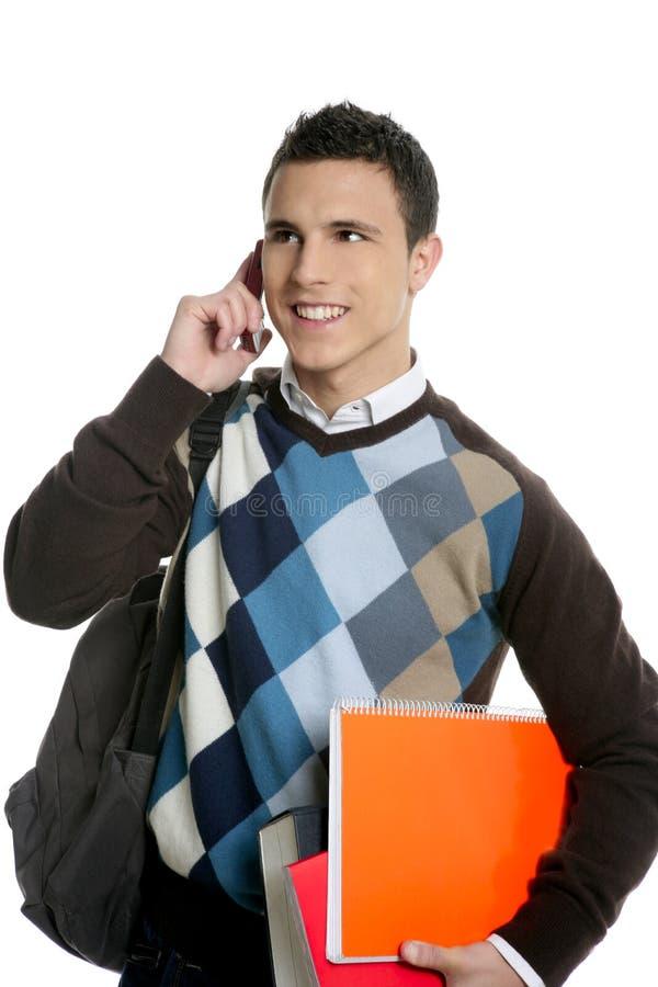 Estudiante con la escuela que va del bolso, del teléfono y de los libros fotos de archivo libres de regalías