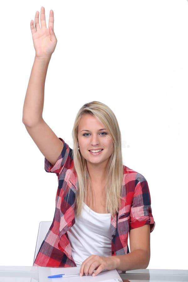 Estudiante con la mano para arriba imagen de archivo