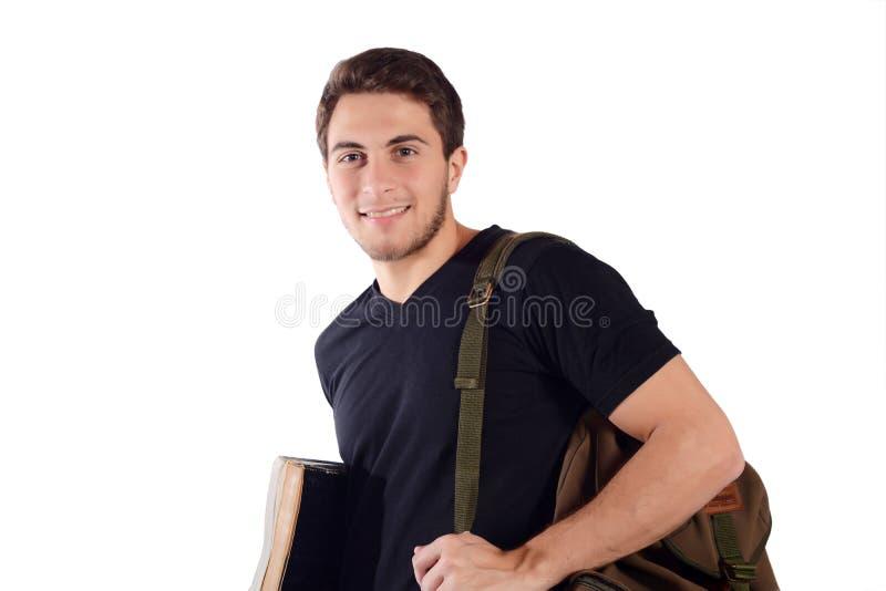 Estudiante con la mochila y el cuaderno fotografía de archivo