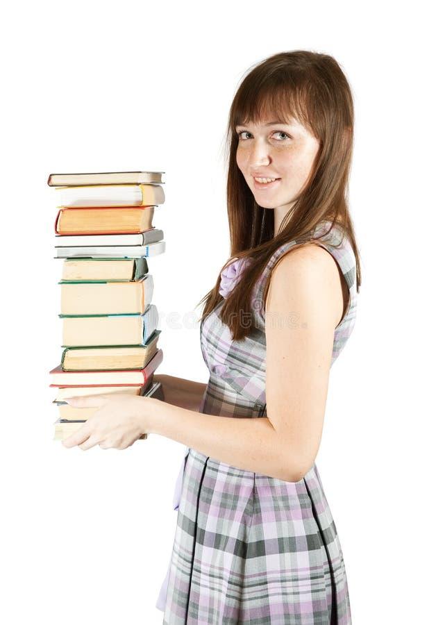 Estudiante con la pila de libros imagen de archivo libre de regalías