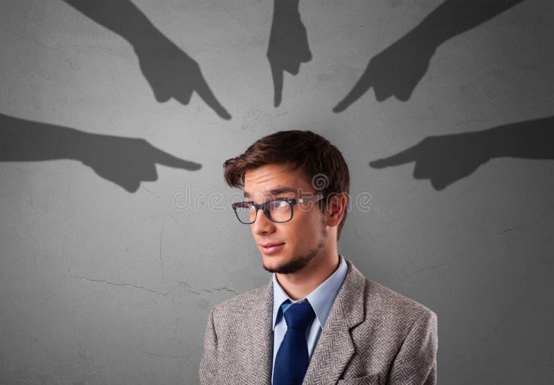Estudiante con se?alar concepto de las manos foto de archivo