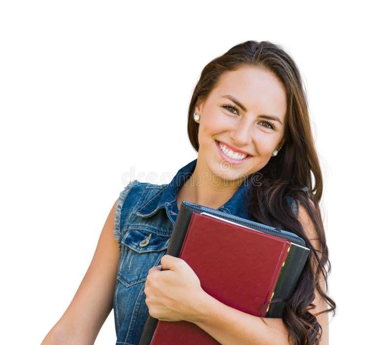 Estudiante de la chica joven de la raza mixta con los libros de escuela aislados en blanco fotografía de archivo