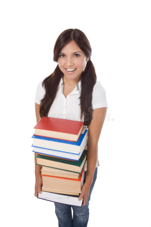 Estudiante de la colegiala de la High School secundaria con los libros de la pila imagenes de archivo