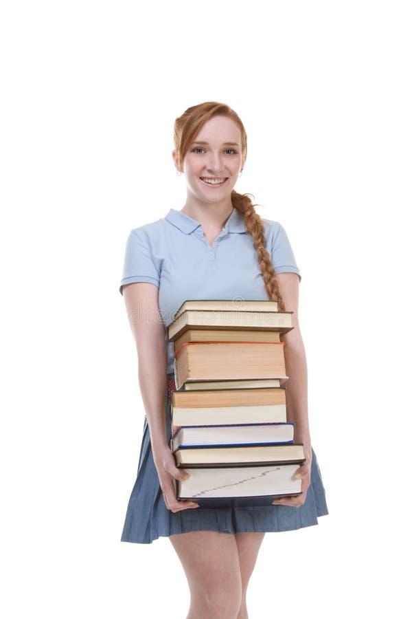 Estudiante de la colegiala de la High School secundaria con los libros de la pila imagen de archivo libre de regalías