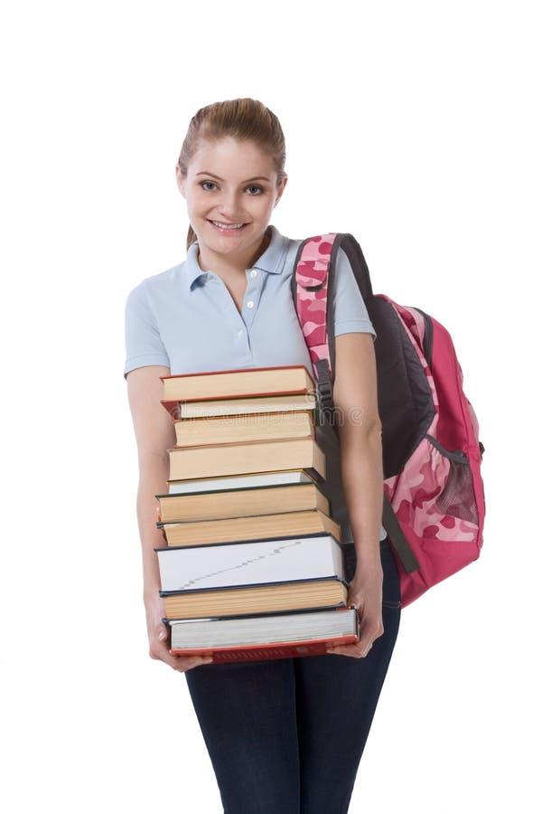 Estudiante de la colegiala de la High School secundaria con los libros de la pila imágenes de archivo libres de regalías