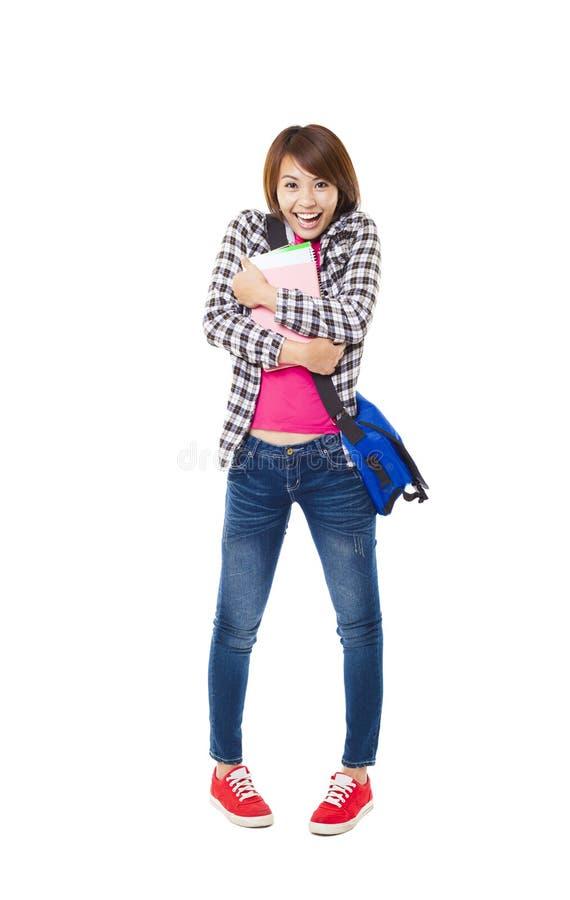 Estudiante feliz joven con los libros y aislado en blanco fotos de archivo libres de regalías
