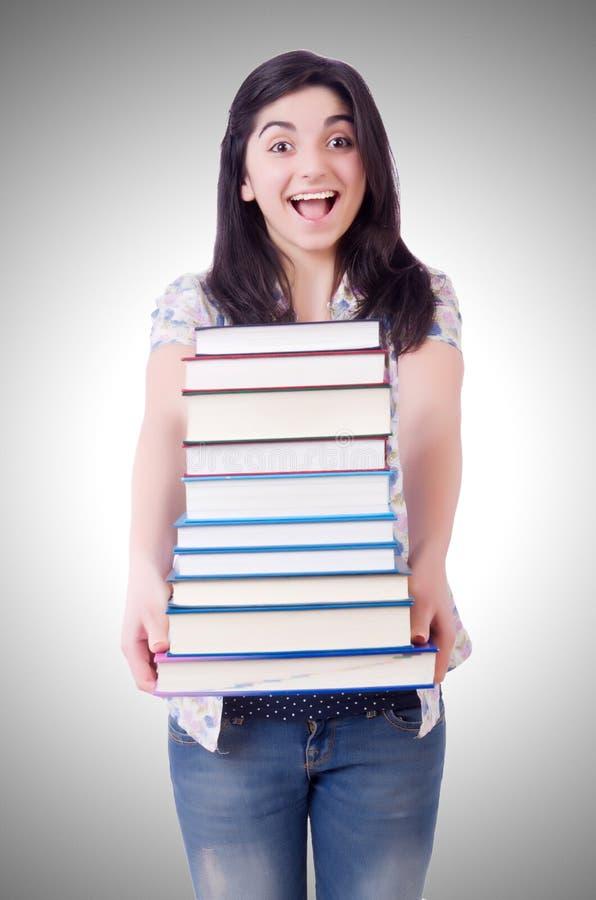 Estudiante femenino joven con los libros imagenes de archivo