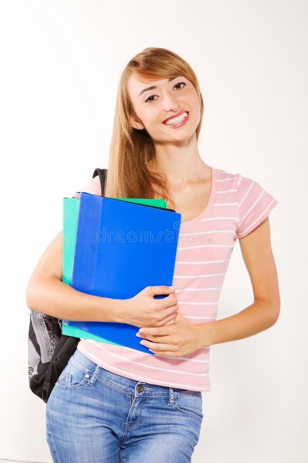 Estudiante femenino sonriente agraciado imagenes de archivo