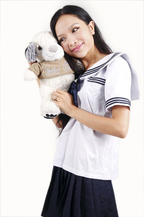 Estudiante femenino y perro de juguete fotos de archivo