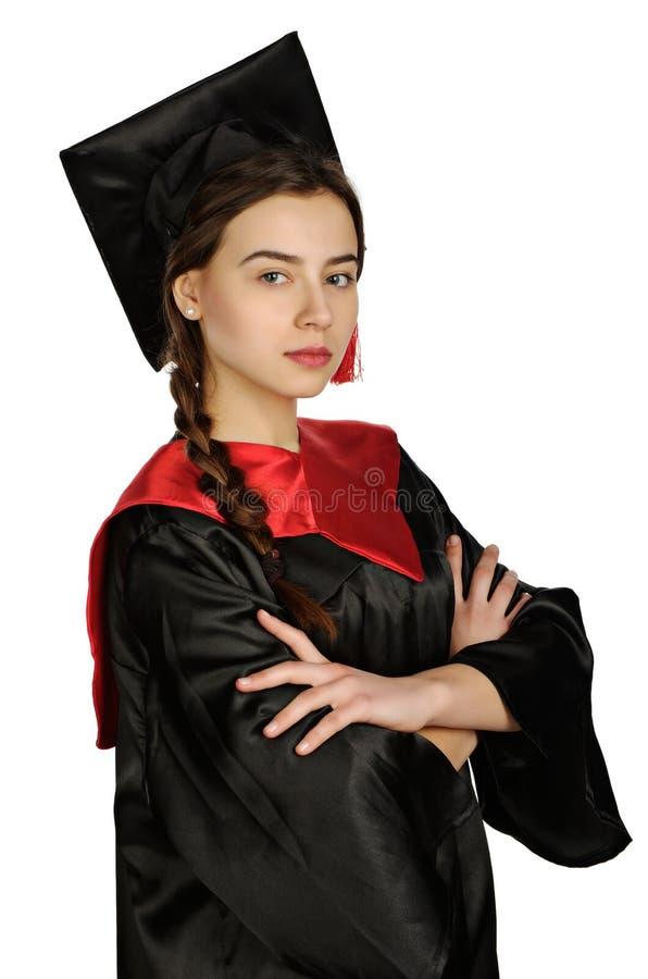 Estudiante graduada hermosa en capa imagen de archivo