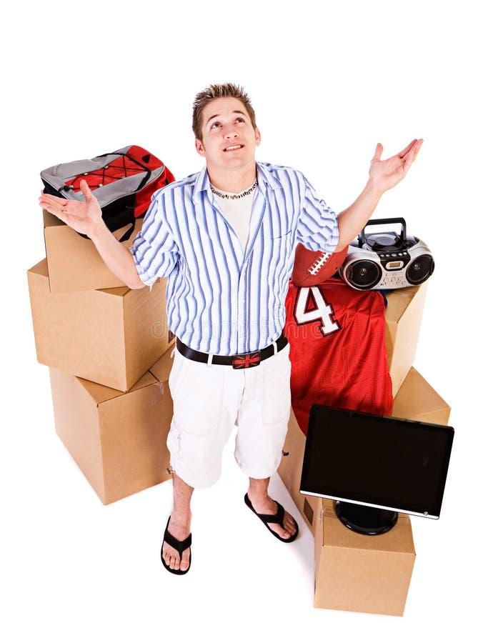 Estudiante: Guy Has Too Much Stuff a moverse al sitio del dormitorio fotografía de archivo