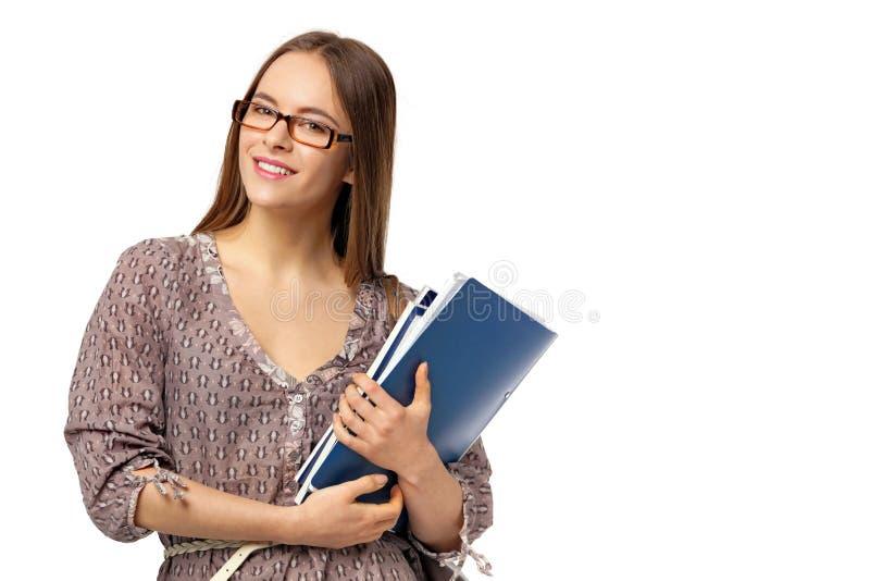 Estudiante hermoso con los libros en blanco imagen de archivo