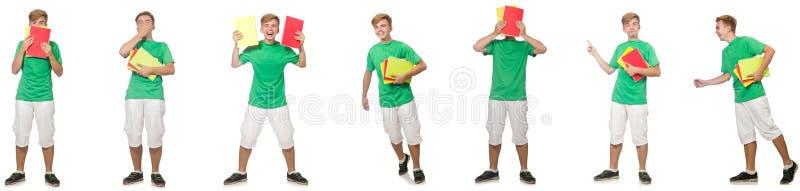 Estudiante joven con las notas aisladas en blanco imagen de archivo libre de regalías