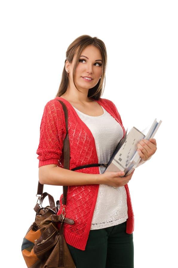 Estudiante joven que lleva una pila de libros foto de archivo libre de regalías