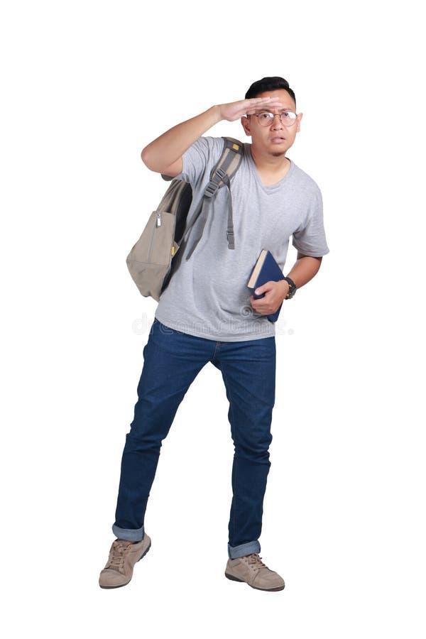Estudiante joven Standing Looking Far adelante fotos de archivo