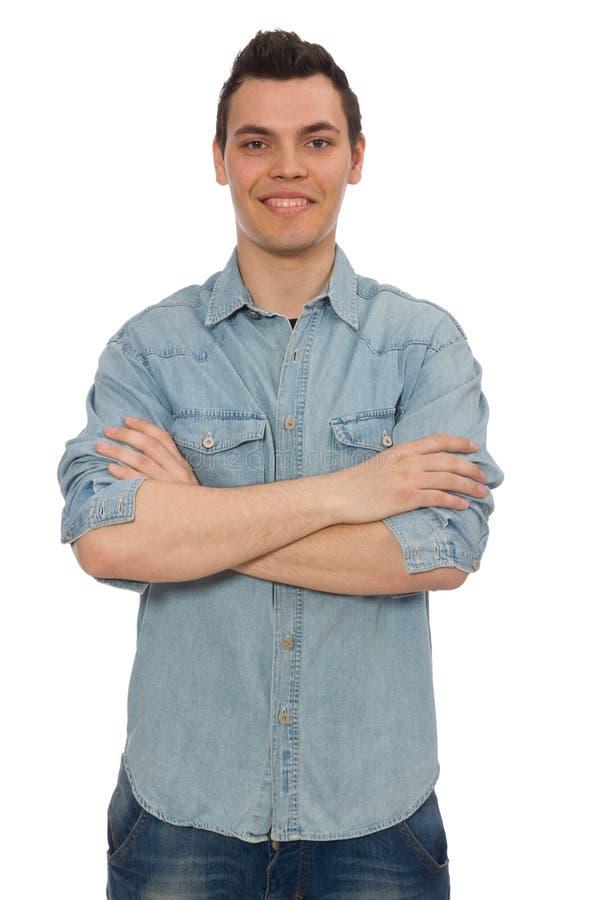Estudiante masculino joven aislado en blanco fotografía de archivo