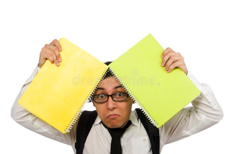 Estudiante masculino que lleva a cabo notas aisladas en blanco foto de archivo libre de regalías
