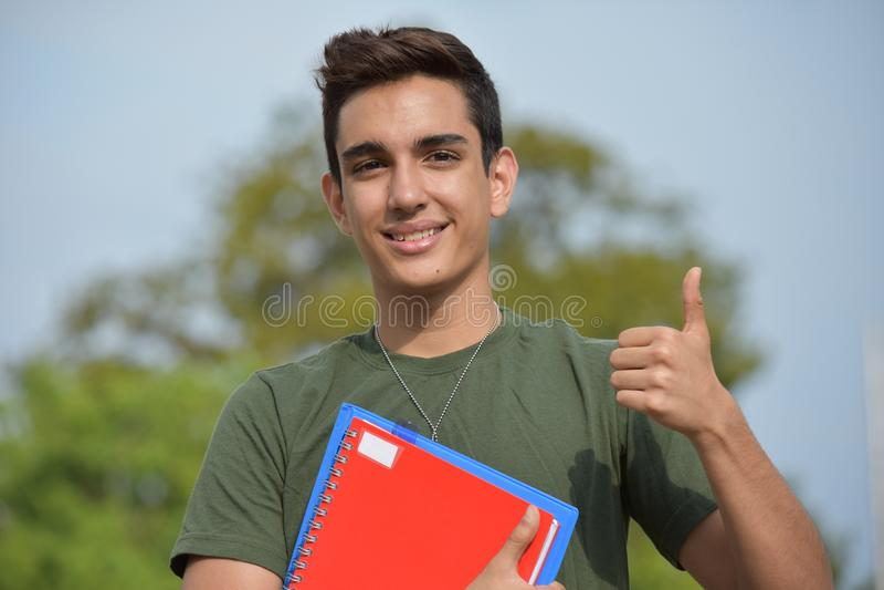 Estudiante militar adolescente masculino hispánico And Success imágenes de archivo libres de regalías