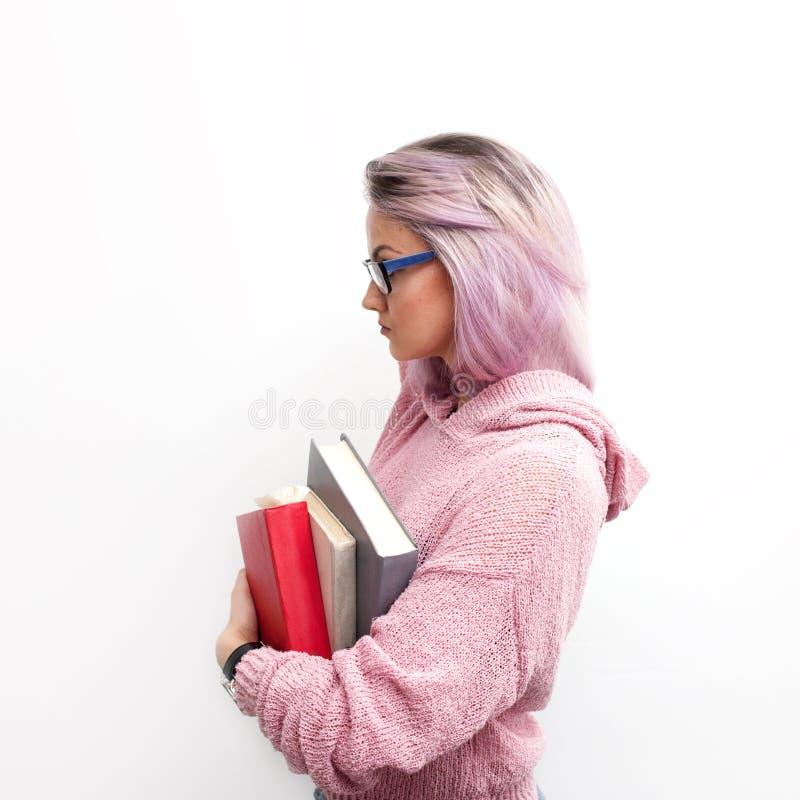 estudiante Mujer joven con los libros La muchacha agradable está lista para aprender fotografía de archivo