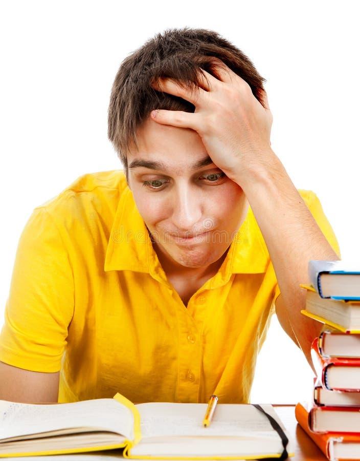 Estudiante preocupado con libros imagen de archivo libre de regalías