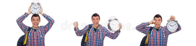 Estudiante que sostiene el despertador aislado en blanco imagen de archivo libre de regalías