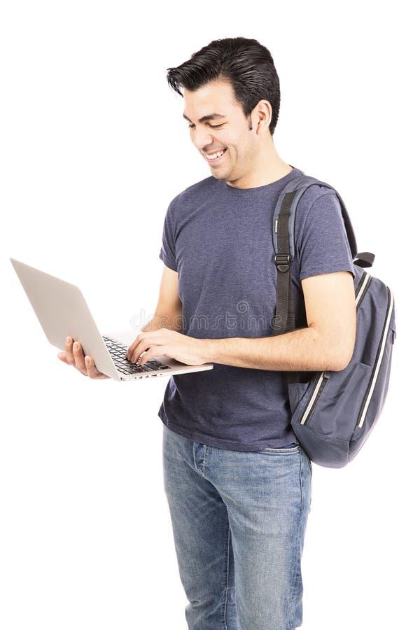 Estudiante que usa un ordenador portátil fotos de archivo