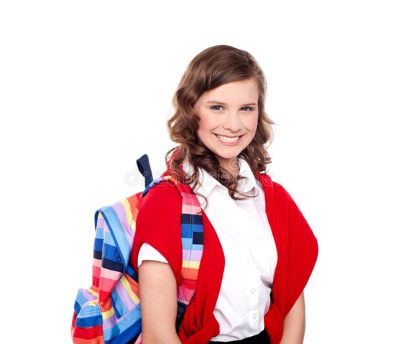Estudiante sonriente del adolescente con el bolso colorido foto de archivo