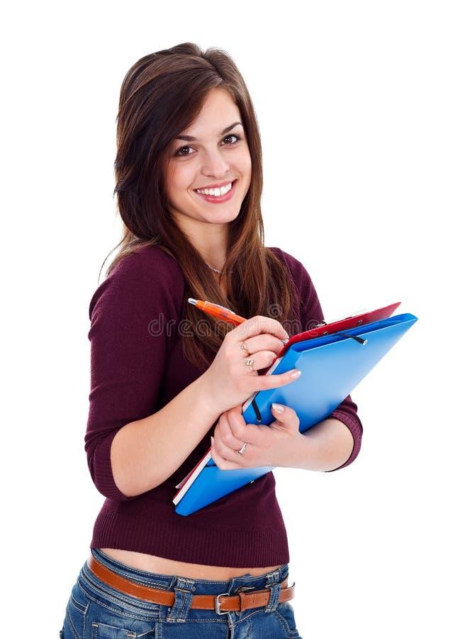 Estudiante sonriente que toma notas imagen de archivo