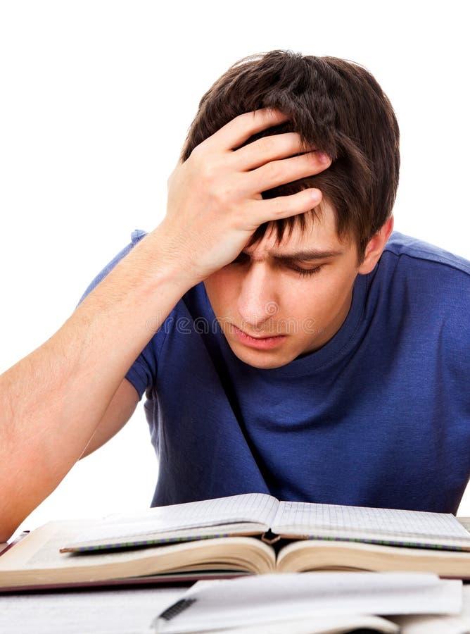 Estudiante triste con libros imagen de archivo