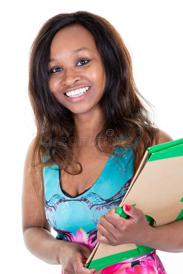 Estudiante universitaria afroamericana de la mujer joven del estudiante fotos de archivo
