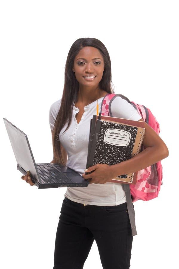Estudiante universitario del afroamericano con PC de la computadora portátil imágenes de archivo libres de regalías