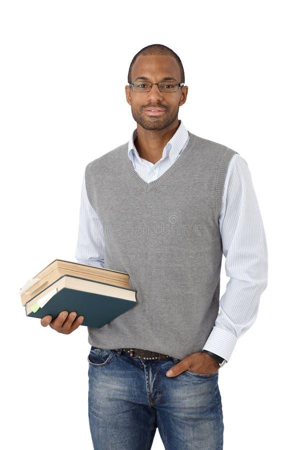 Estudiante universitario elegante con los libros imagen de archivo libre de regalías