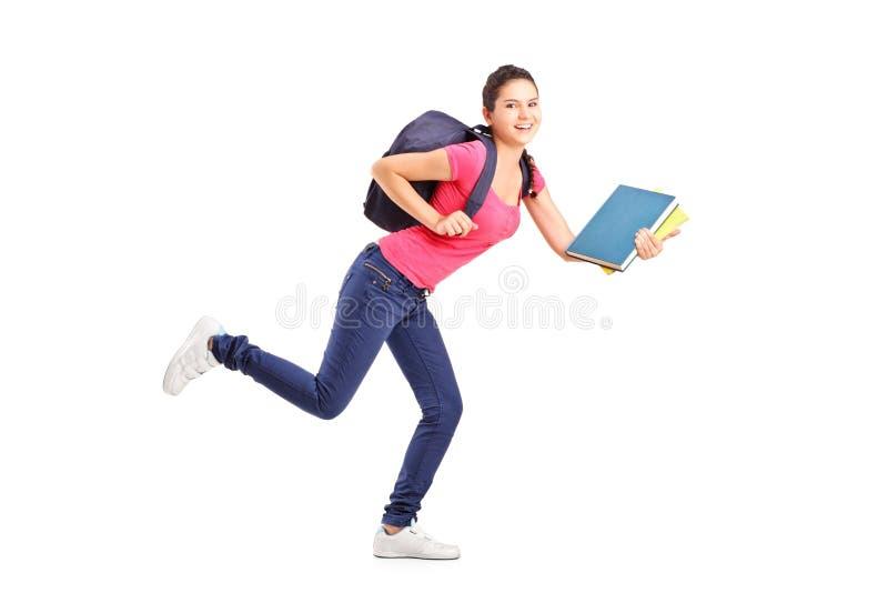 Estudiante universitario en una prisa que se ejecuta con los cuadernos fotos de archivo libres de regalías