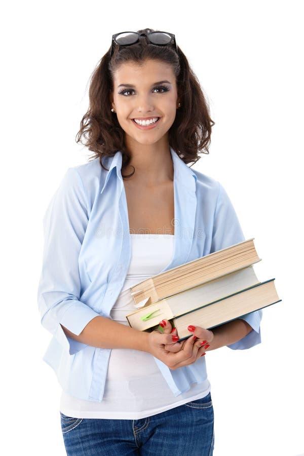 Estudiante universitario sonriente con los libros imagenes de archivo