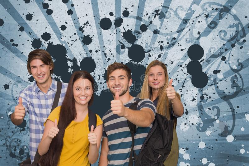 Estudiantes jovenes felices contra fondo salpicado azul fotografía de archivo