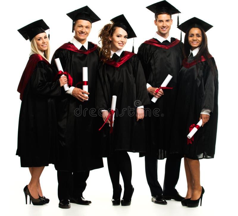 Estudiantes jovenes graduados imagen de archivo libre de regalías