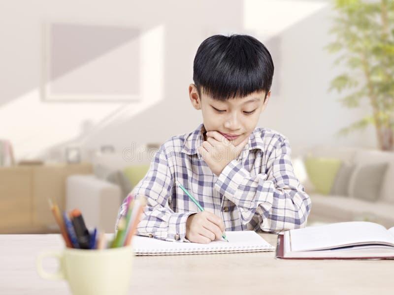 Estudo asiático da criança fotografia de stock