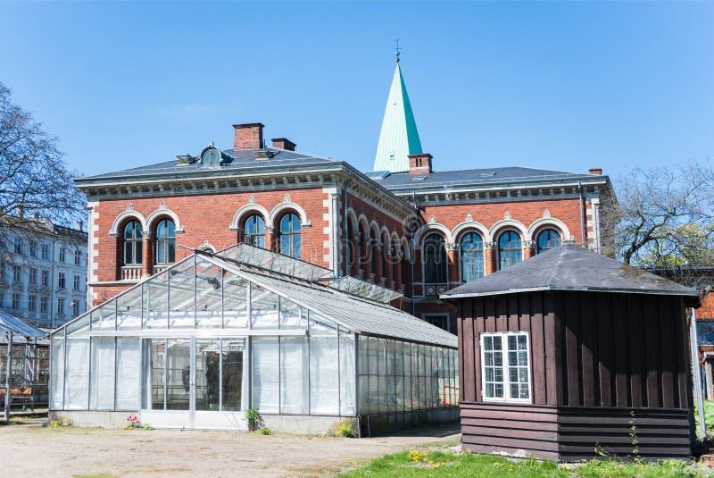 estufa e construções no jardim botânico imagens de stock royalty free