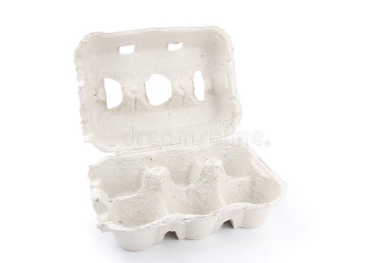 Esvazie a caixa de 6 ovos no branco imagem de stock