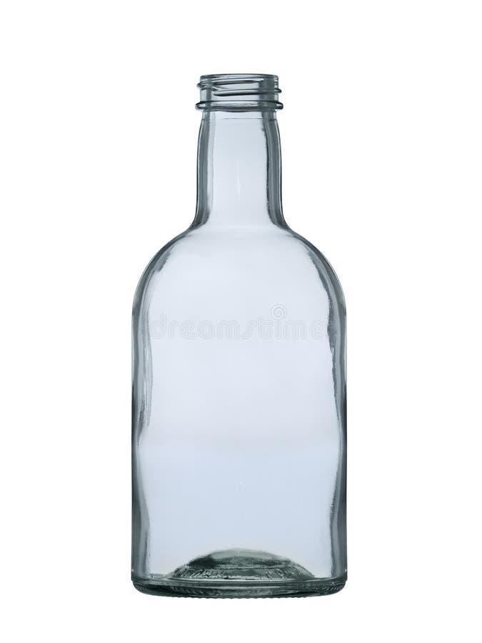 Esvazie a garrafa de vidro para a vodca, uísque, conhaque, aguardente isolada no fundo branco fotografia de stock