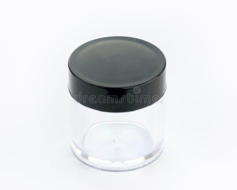 Esvazie o frasco pequeno do plástico ou do vidro com tampa preta fotografia de stock royalty free