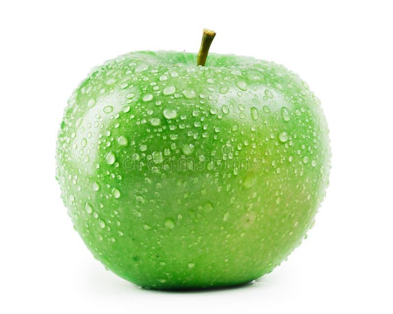 Esverdeie a maçã com gotas da água fotos de stock