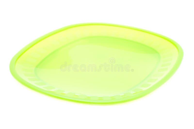 Esverdeie o prato plástico fotos de stock