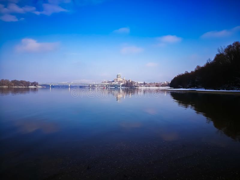 View of Esztergom. Basilica in Esztergom from the distance across river Danube in winter in snow royalty free stock photography