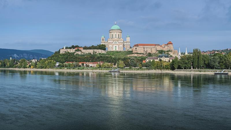 Esztergom Basilica, Hungary. View of the Esztergom Basilica at the Castle Hill from the opposite bank of Danube, Hungary. The Latin motto on the temple frieze stock image