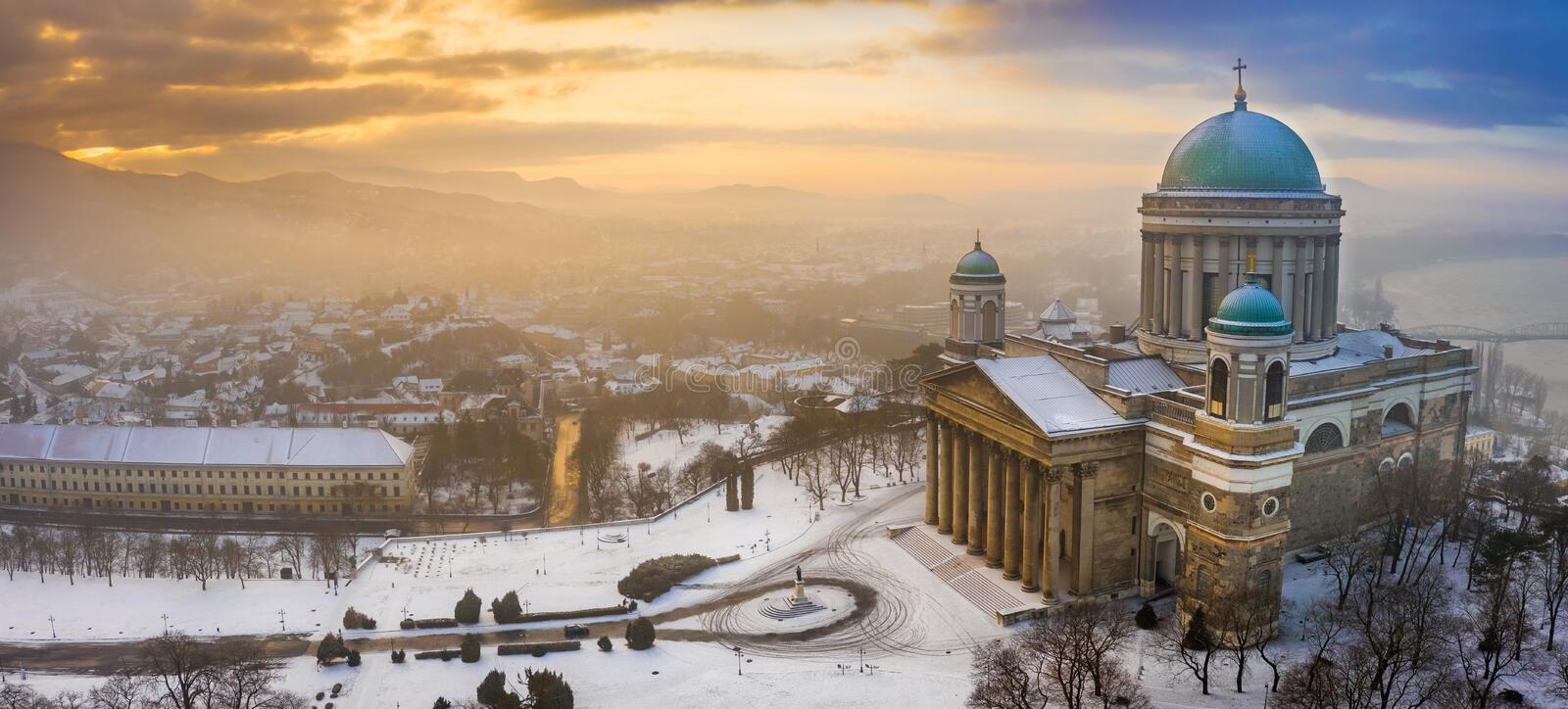 Esztergom, Hungary - Aerial panoramic view of the snowy Esztergom Basilica with a winter sunrise. Esztergom, Hungary - Aerial panoramic view of the snowy royalty free stock photography
