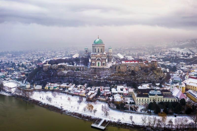 Esztergom, Hungary - Aerial skyline view of Esztergom with the beautiful snowy Basilica on a foggy morning. Esztergom, Hungary - Aerial skyline view of Esztergom royalty free stock photo